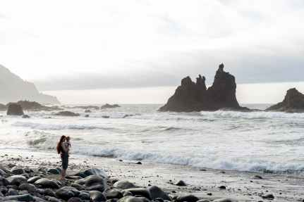 lonely woman with child on rocky coast